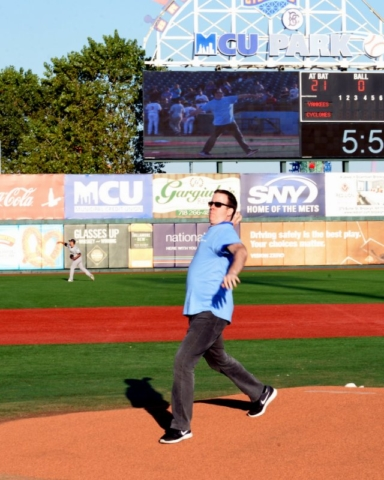Dr. Anthony Corcoran throwing the first pitch