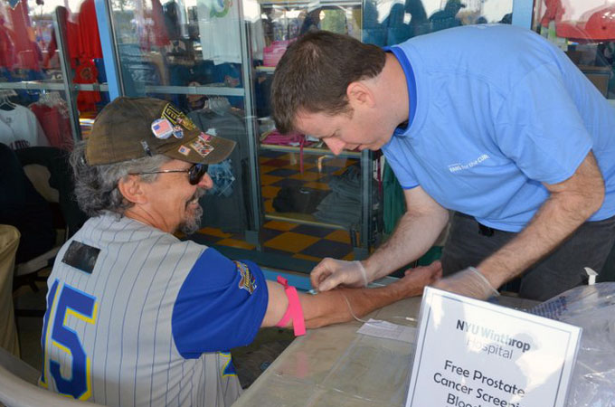 Dr. Anthony Corcoran conducts a PSA screening