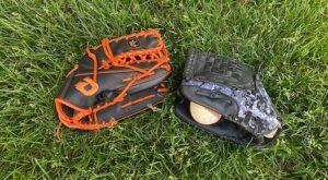 Two baseball mitts and a baseball
